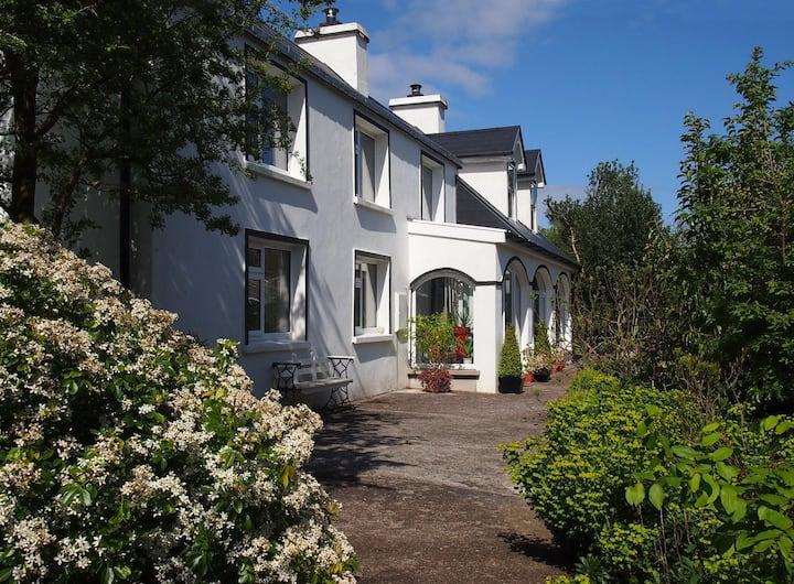 Ballycommane House B&B overlooking lush gardens