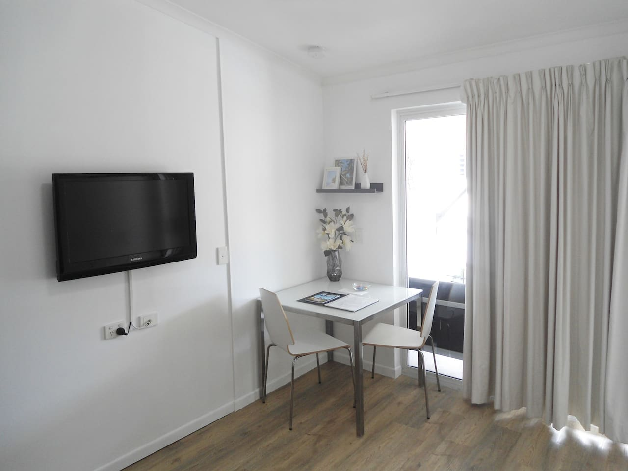 Studio with double bed, wardrobe, table, TV