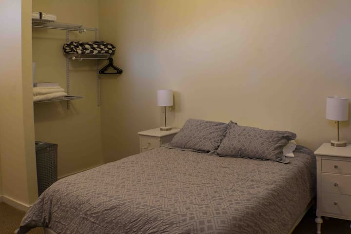 Loft bedroom with queen bed. Both lamps equipped with USB ports.