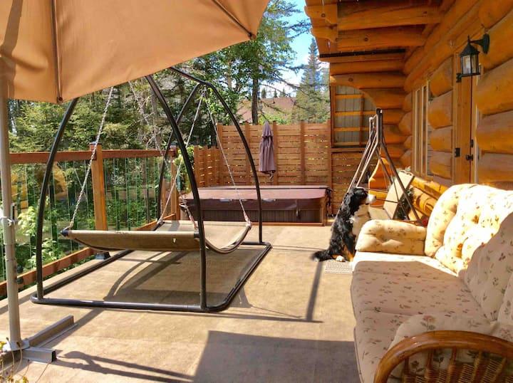 2 chambres dans maison en bois rond avec vue