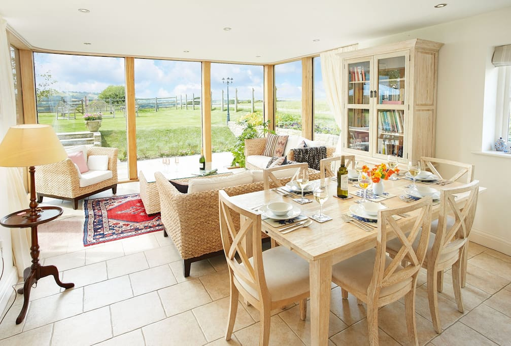 Ground floor: The dining area is furnished with a limed oak wooden table to seat eight