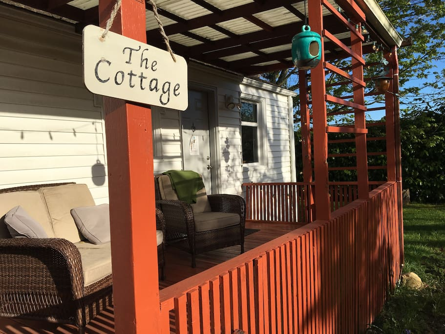 Back of the cottage faces a private fully enclosed yard with maple and walnut trees.