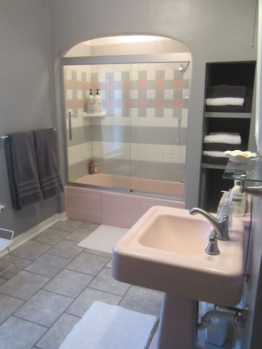 Newly renovated bathroom with tub/shower, and plush towels to enhance your experience.