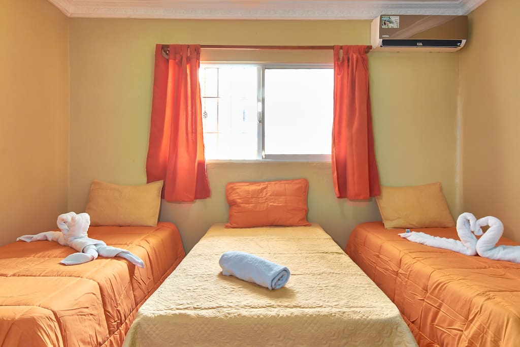 Bedroom with 3 single beds. Free air conditioning - from 8pm to 8am - Air conditioning during daytime is available for U$10 per day.