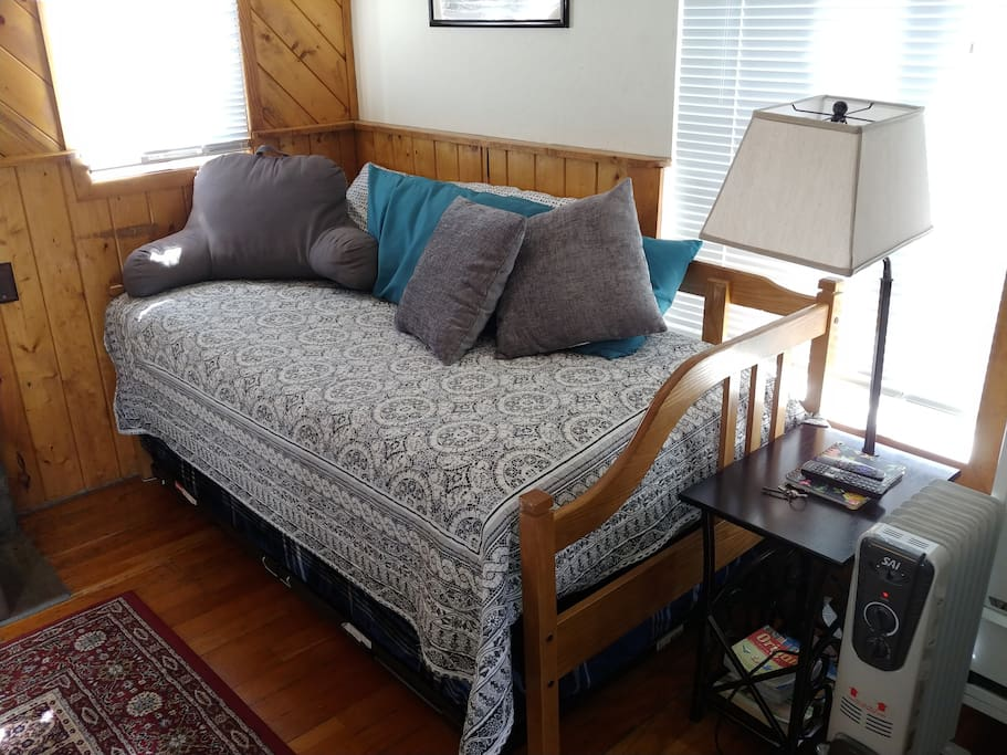 There is a trundle bed under the daybed