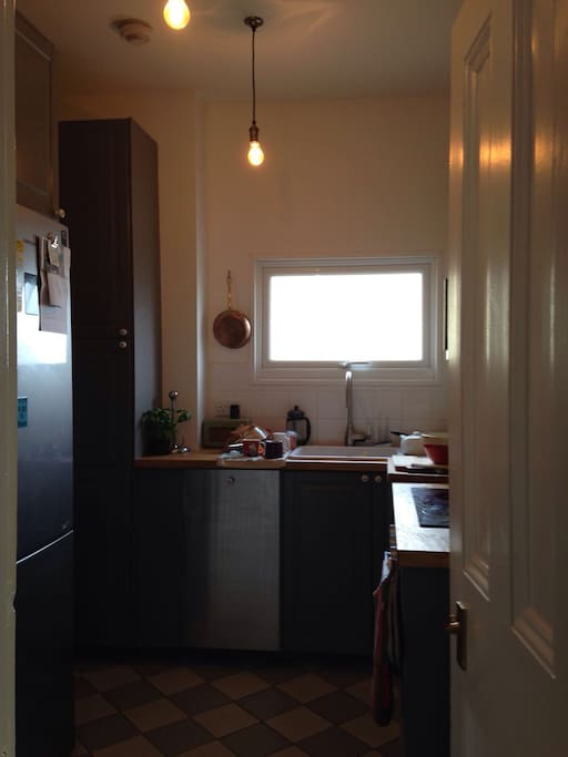 Kitchen with large Fridge Freezer, microwave, oven and induction hob