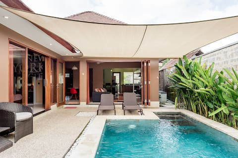 Walk to the Beach from a Spirited Villa with a Pool