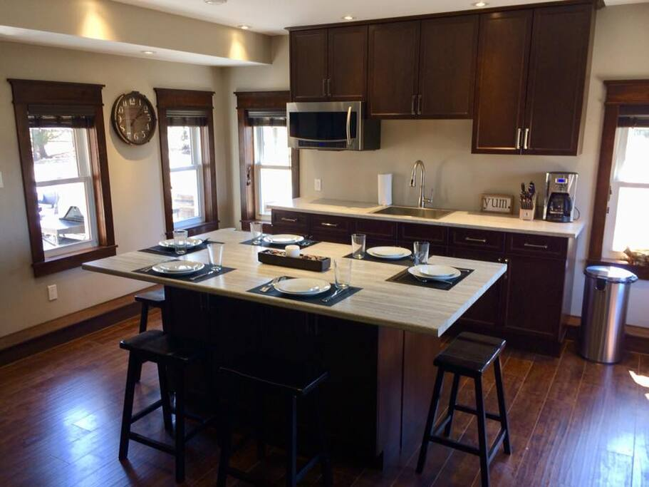 Large spacious eat in kitchen, which comes supplied with: coffee, selection of teas, sugar, salt and pepper, cooking oil, cooking spray, suran wrap, tin foil, ziplock bags, glass bowls with lids for storing leftovers.