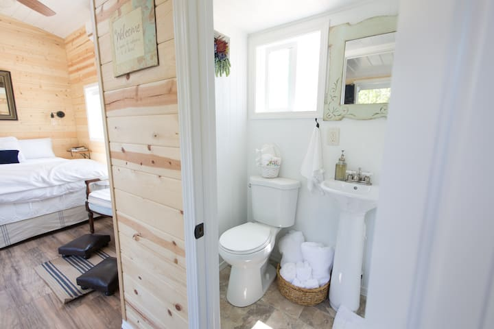 Surrounded by cedar walls with a full bathroom and large shower.