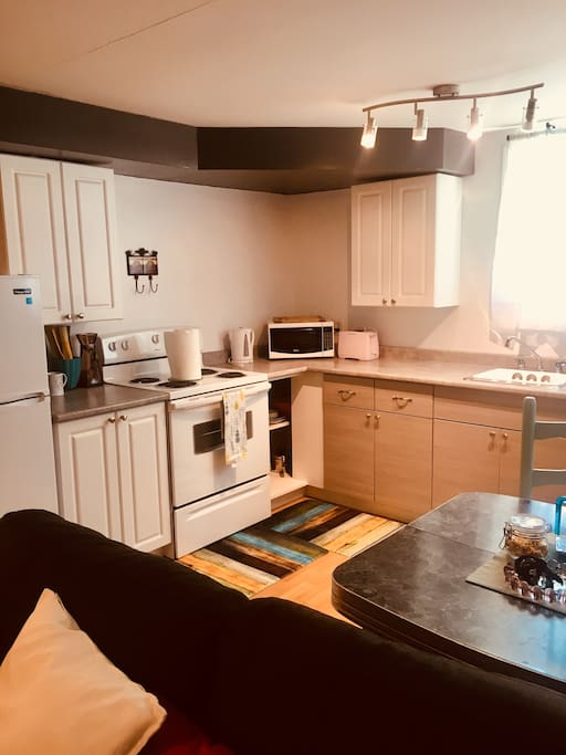 Kitchen has all new appliances and fresh ground coffee waiting to be brewed.