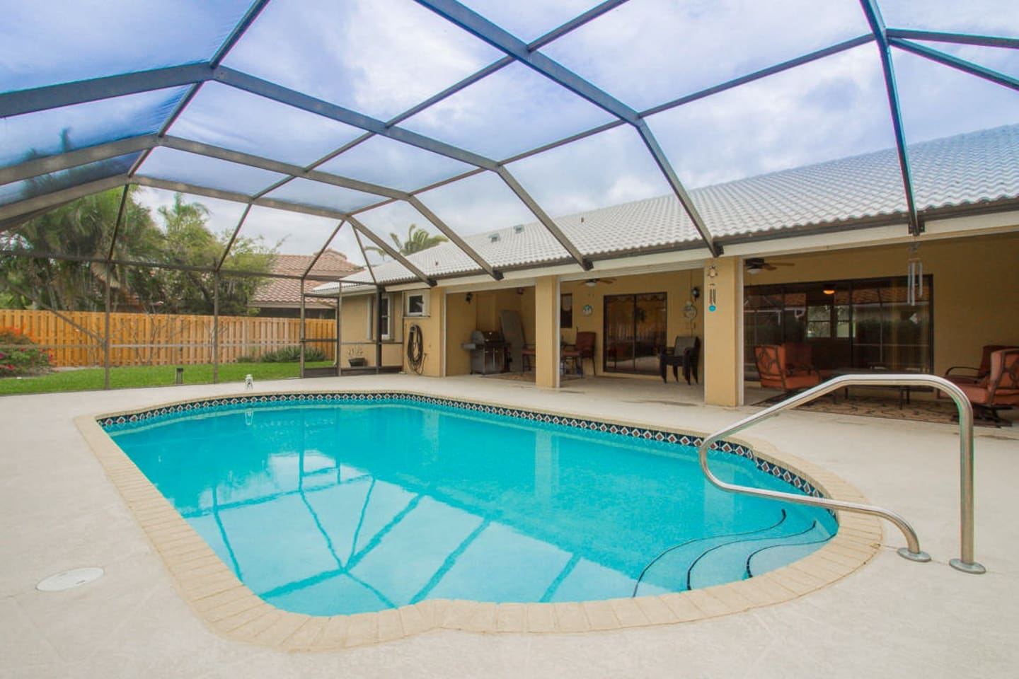 Relax by our enclosed pool or grill dinner on the patio.  NOTE:  There is a child safety fence (removable) that surrounds the pool now - worry free enjoyment for the whole family :)