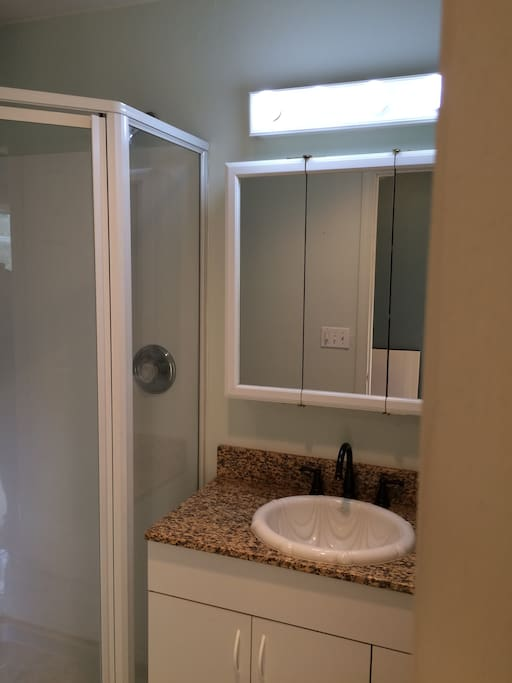 Bathroom with shower attached.