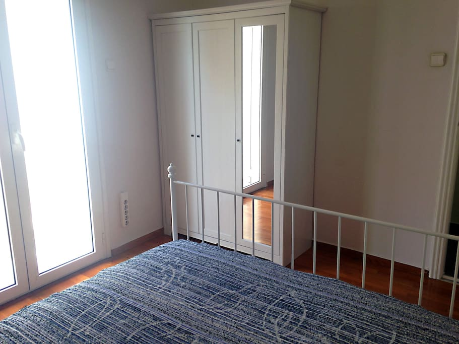 Different angle. Wardrobe with mirror.