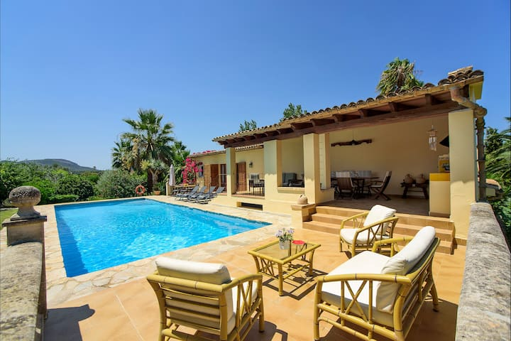 Poolside seating and Covered BBQ Terrace