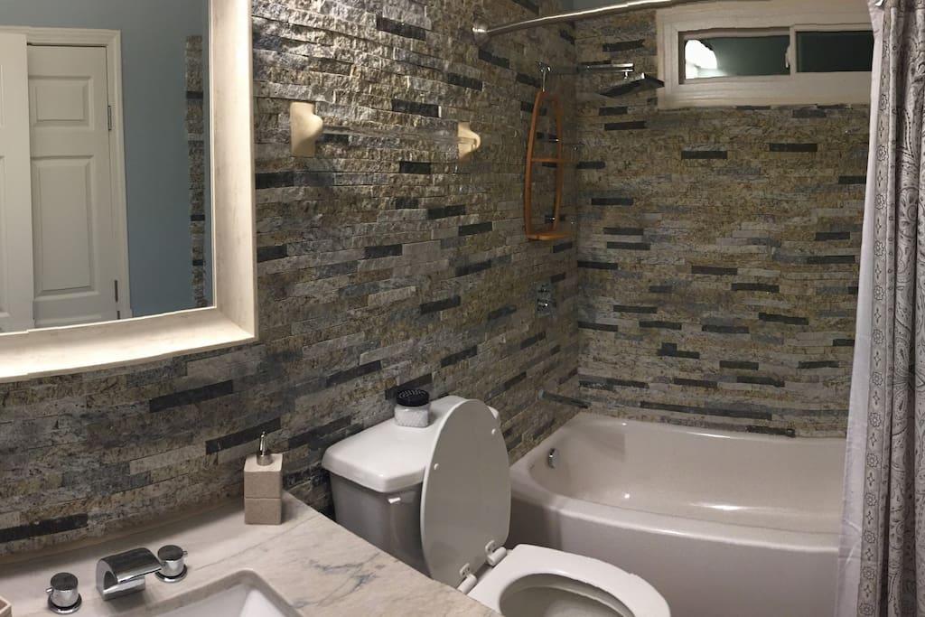 Full Bath w/ Rain shower head and tub.