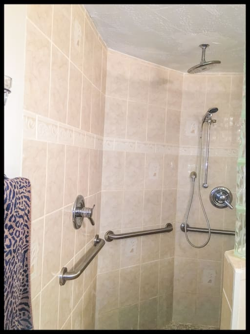 2 shower heads.. (one waterfall and one that detaches) nice size bathroom all to yourself!