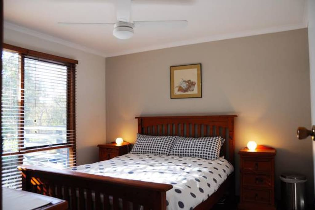The main bedroom leads onto the ensuite bathroom and has a lovely double window. It also has a ceiling fan.