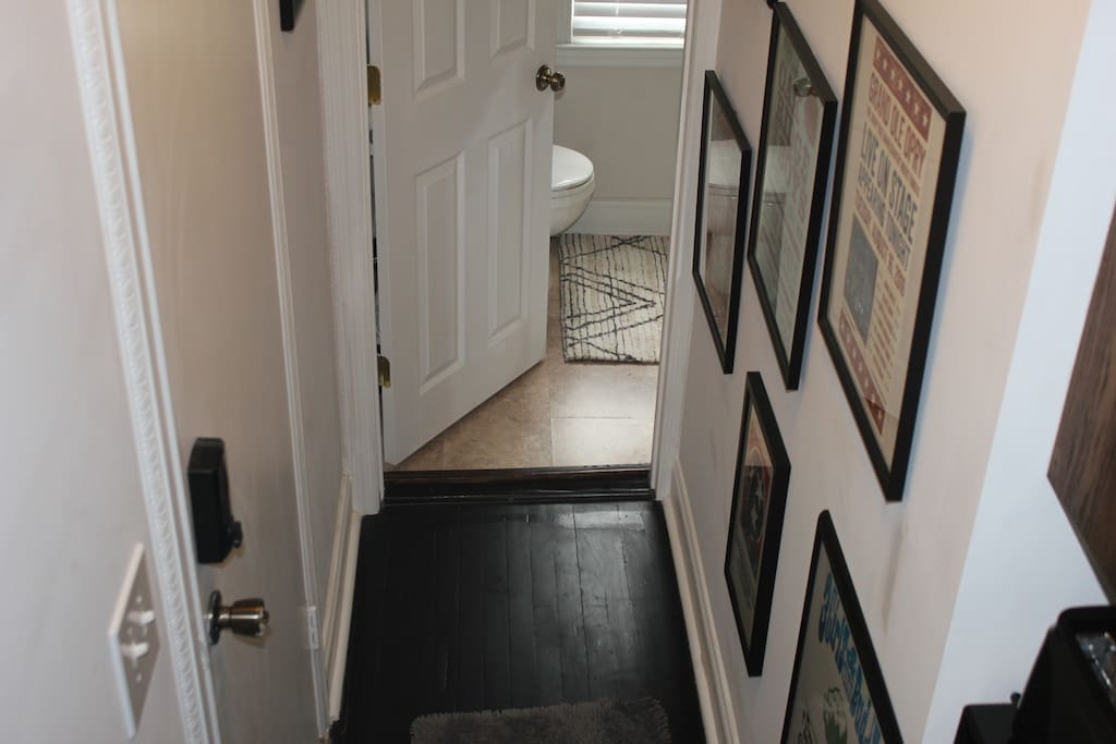 the entry hall leads to a spacious full bathroom