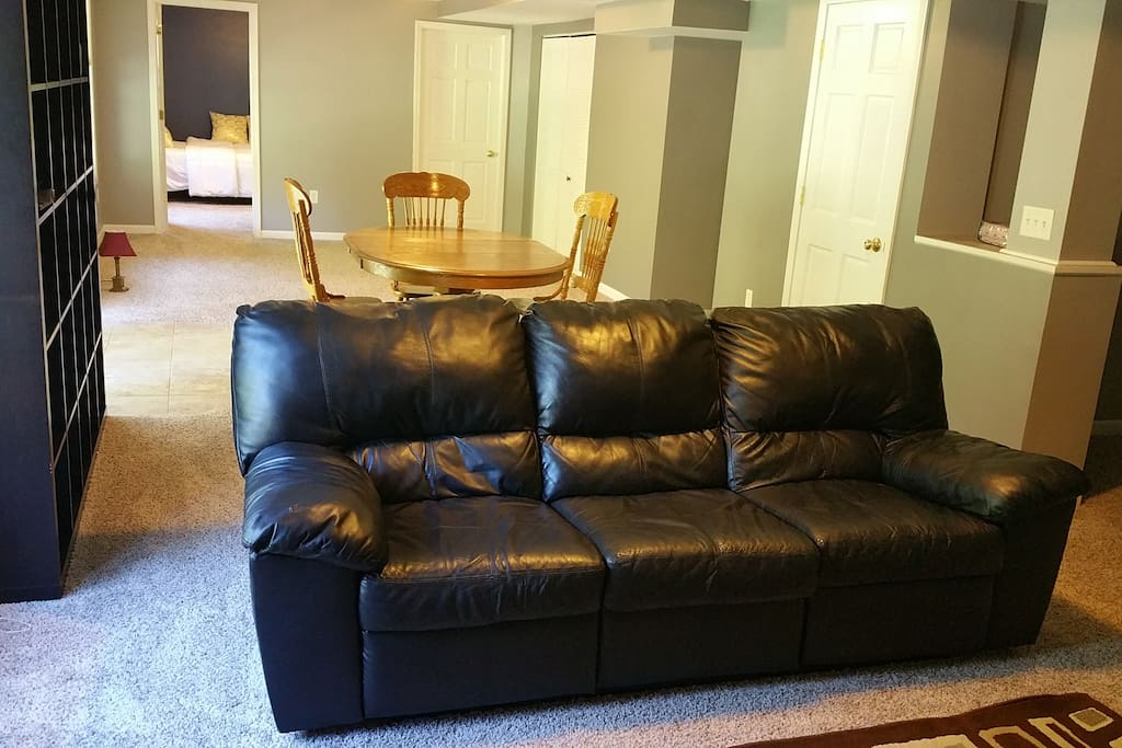 Basement area with recliner sofa