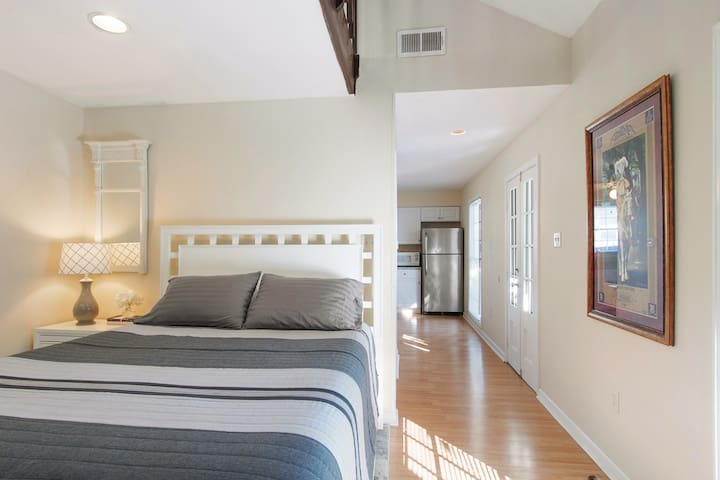 Comfortable Queen bedded bedroom with TV, cable, storage armoire and great natural light