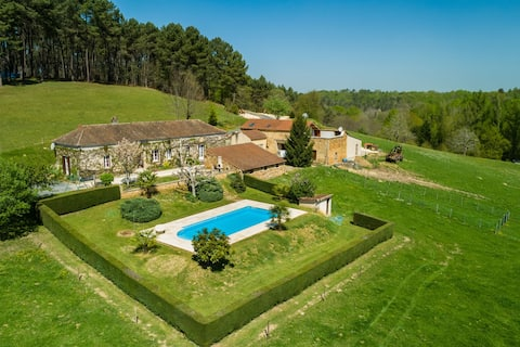 Panoramic views of nature near Loubejac at beautifully situated holiday home.