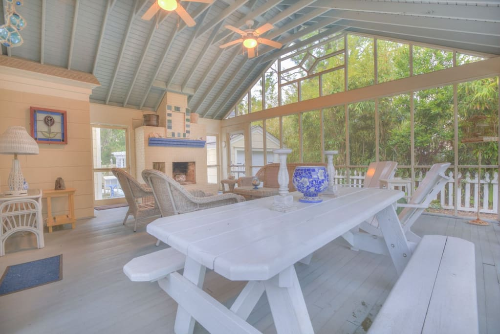 Large screened outdoor living room with comfortable seating for the whole guest list