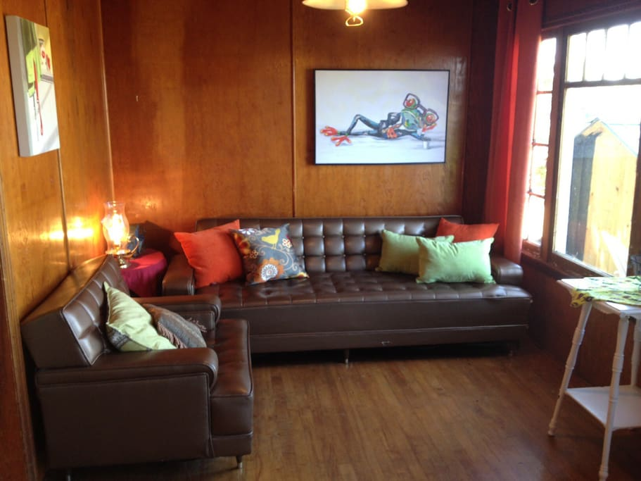 Living room -old but clean and functional furniture. Sofa folds down for additional single sleeping space.