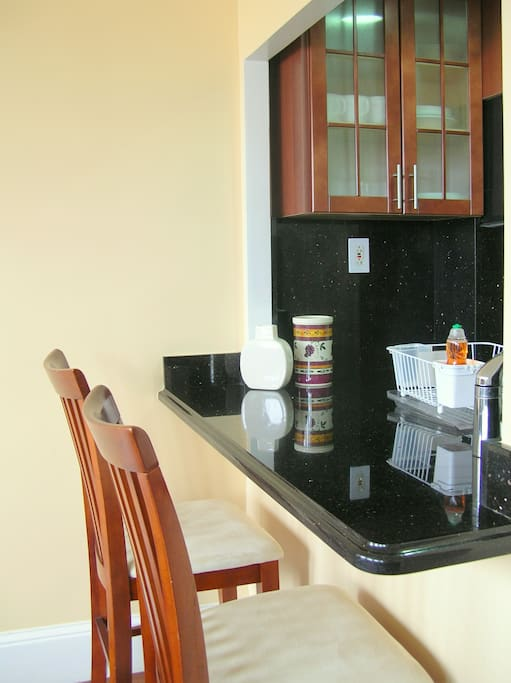 KITCHEN DINING COUNTER --- Oak Cabinets & Granite Counters