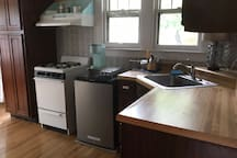 Fridge and stove in kitchen