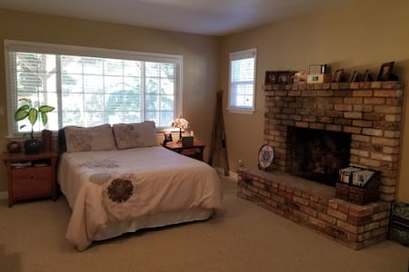 Large room in a home in park-like setting