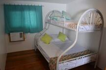 Second bedroom, comfortably accommodates 2 or 3 people. Perfect for friends or your children.