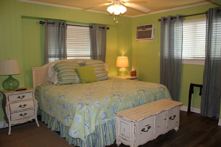Bedroom 3, Downstairs-King Bed with 2 floor mattresses located in the closet.  Flat screen TV included with a kitchenette .  This room is separately accessed from the outside.    There is no access to this room from inside the house.