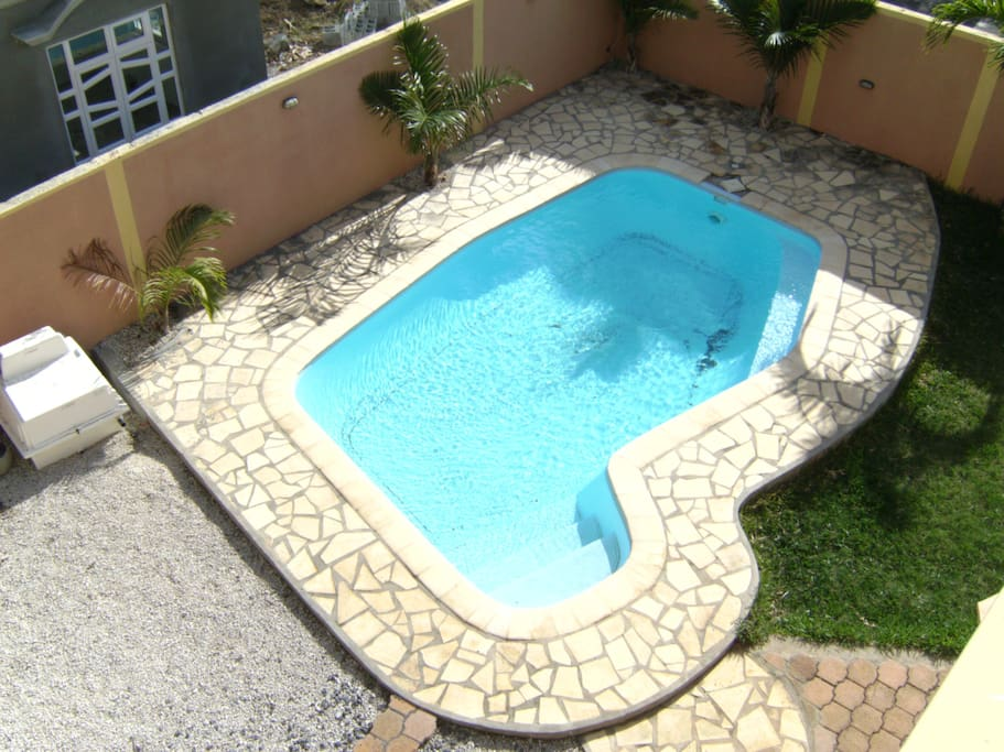 Private swimming pool in the front garden