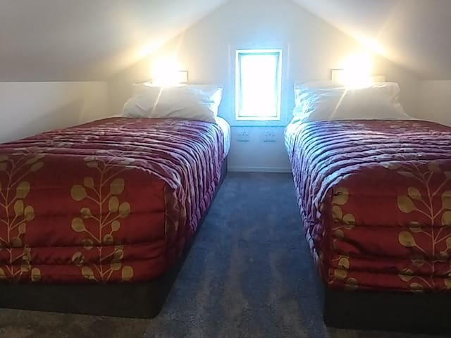 Twin hotel quality beds in loft