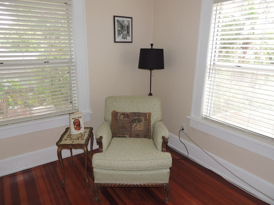 Comfy reading chair surrounded by windows for plenty of natural lighting