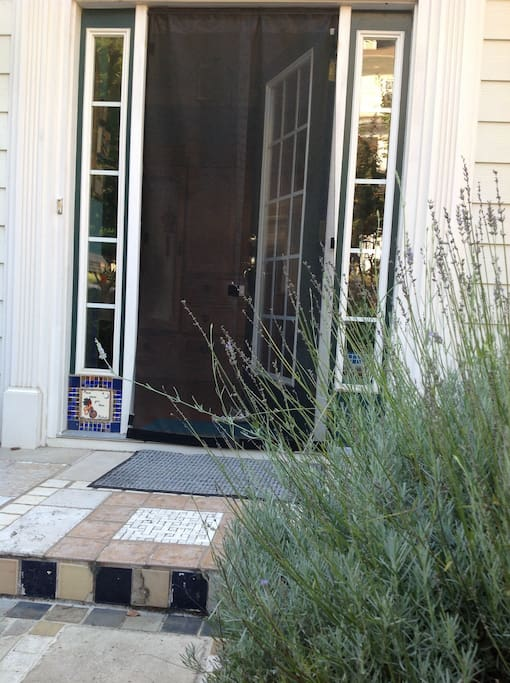 The lavender entry is one step up from the driveway where your parking is always available.