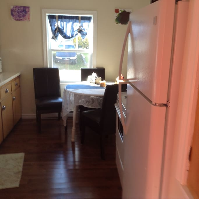 Kitchen has a table and 4 chairs