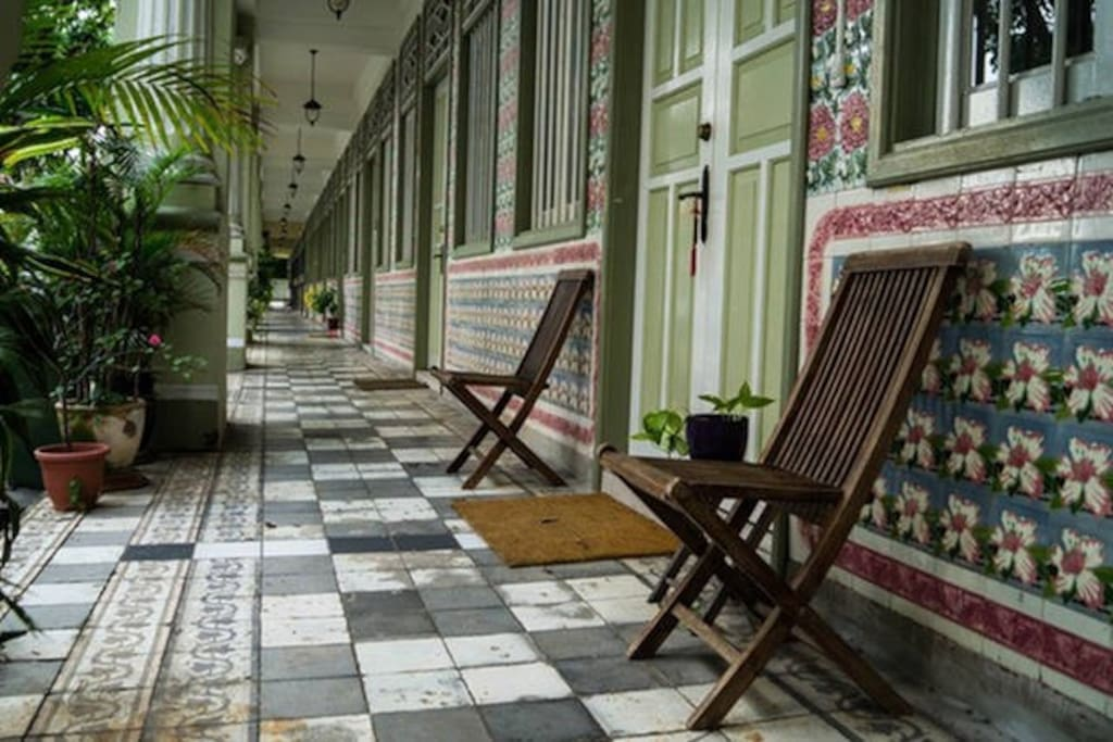 The elegant exterior walkway lined with beautiful vintage tiles and carvings.. :)