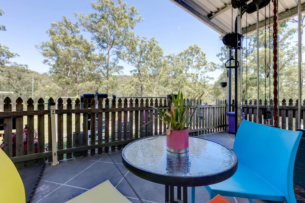 Gorgeous relaxing outdoor patio, overlooking your own little fenced yard, & beautiful natural bushland.