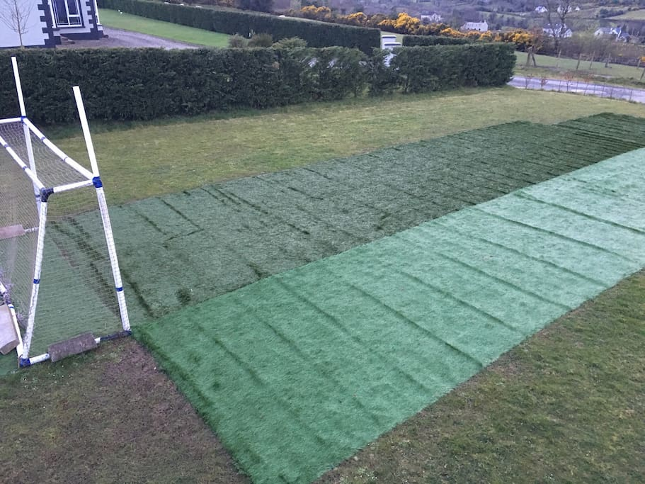 Artificial grass on open area allows the kids to play no matter how wet the garden is.