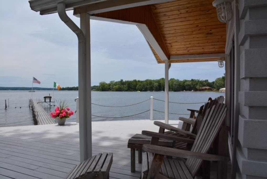 Spacious deck w/Adirondack chairs and umbrella w/seating for 6