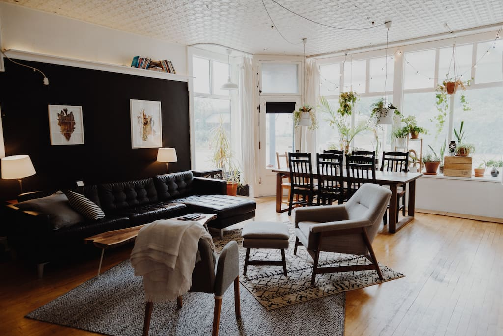 The main living and dining space is large, cozy, and full of cool touches -- local art, great books, and also a large HDTV with all your streaming needs (HBO, Netflix, Hulu, and more).