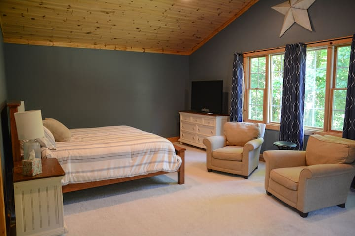 """Master bedroom with king size bed.  Has master bathroom attached.  47"""" tv."""