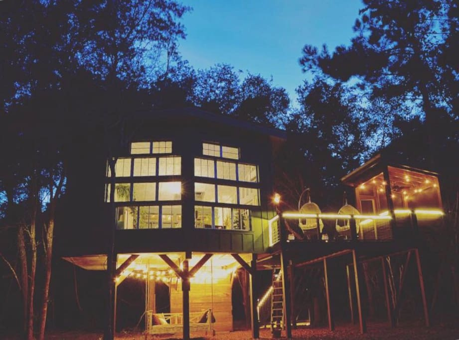 The Living Room Treehouse at night! Outdoor lighting is programmed for your convenience.