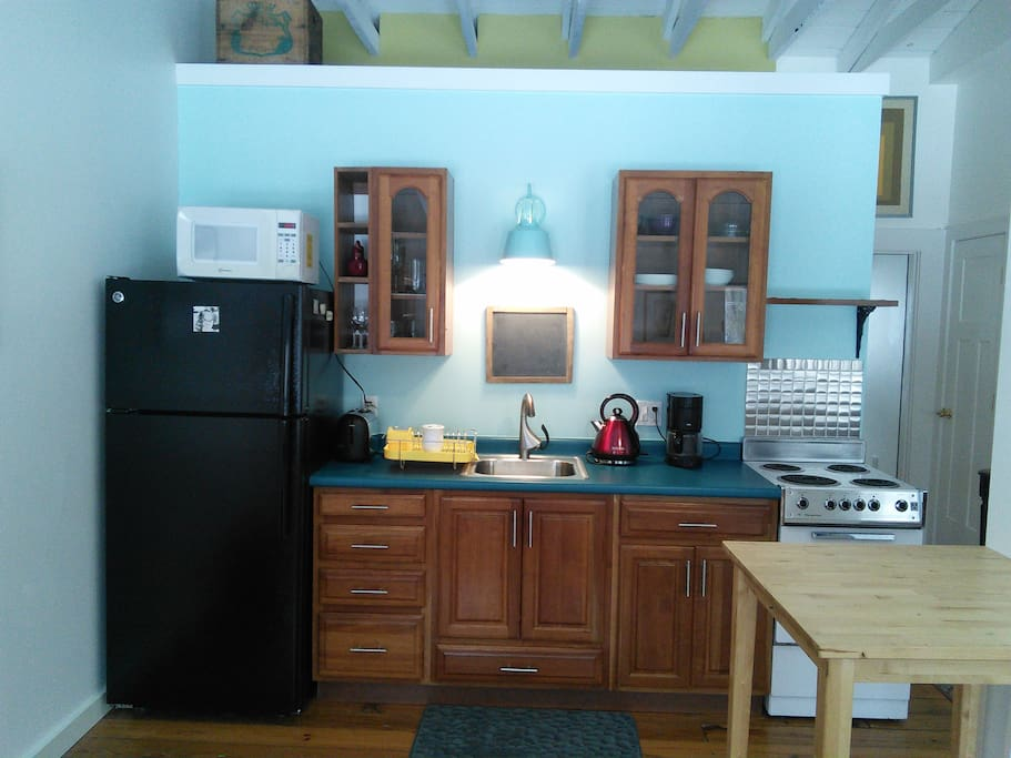 Kitchenette with stove, microwave, coffee maker and the basics for cooking.