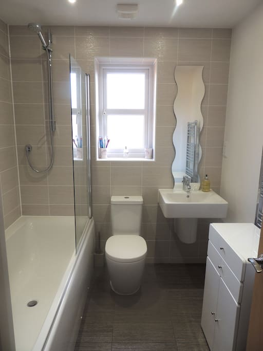 Private bathroom: bath, shower, towels, toiletries.