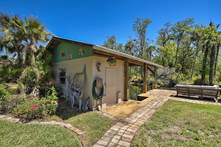 This 3-bedroom, 2-bath home features a lovely outdoor space with a boat house.