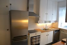 The kitchen has a refrigerator and a freezer, a stove top oven, a dishwasher and a Saeco coffee machine.