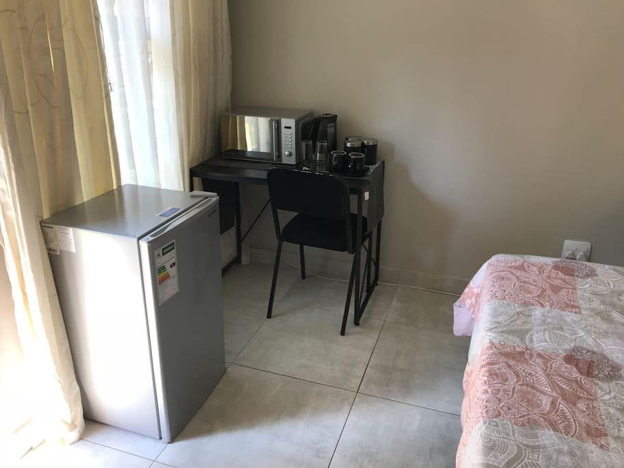 Fridge, microwave and coffee station
