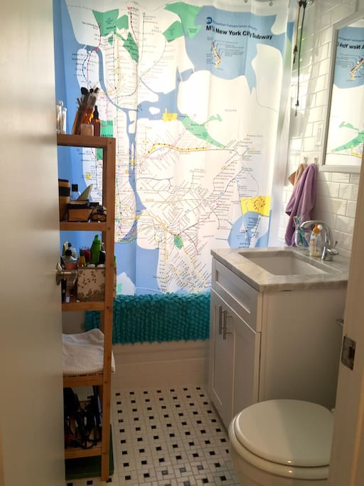Bathroom with subway map shower curtain